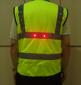 LED light turning signal safety vest green middle red
